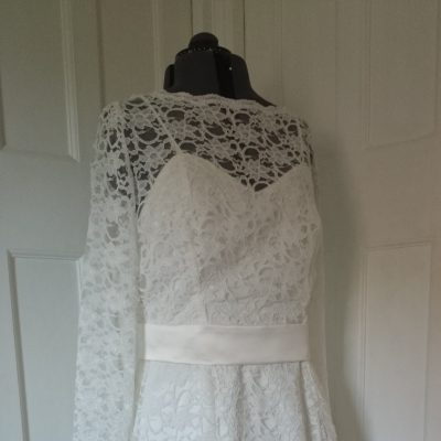 Tea length lace wedding dress with satin belt and button back