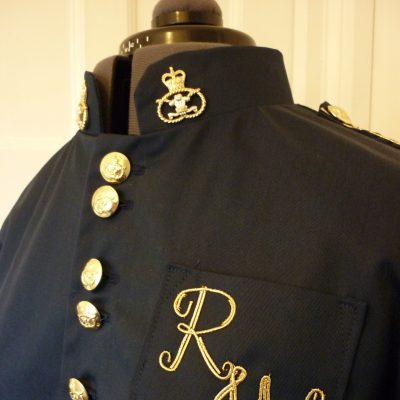 Coat with gold trim