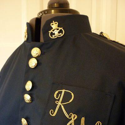 Coat with gold trim