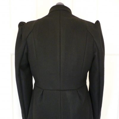 Black melton coat with shoulder detail
