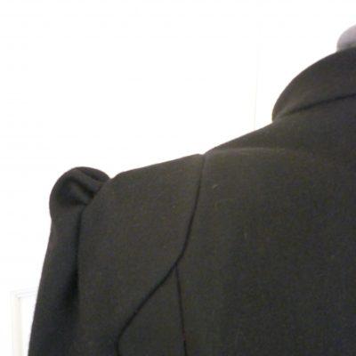 Black melton coat with shoulder detail