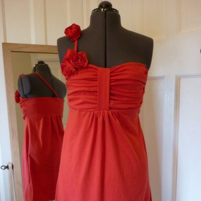 Red jersey prom dress with moveable flower detailing