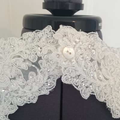 Back detailing of a beaded lace, tulle and satin wedding gown