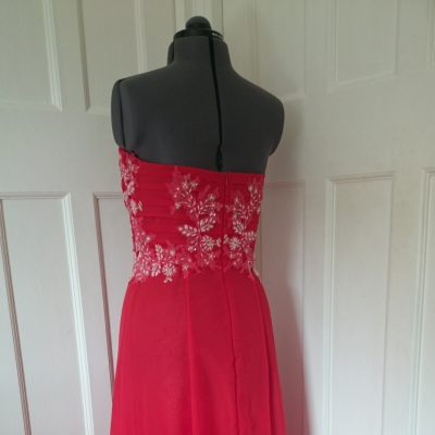 red chiffon prom dress with pleated bodice and beaded embellishments