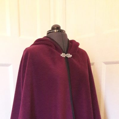 berry fleece cape with black satin edging