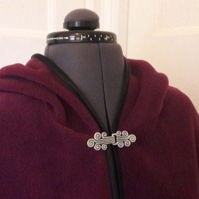 berry fleece cape with black satin edging