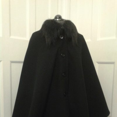 black wool cape with a fur collar
