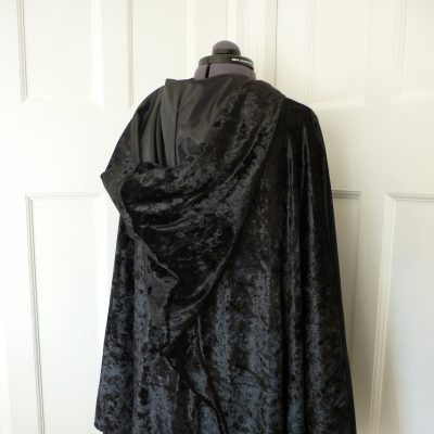 black velvet cape with a pointed hood
