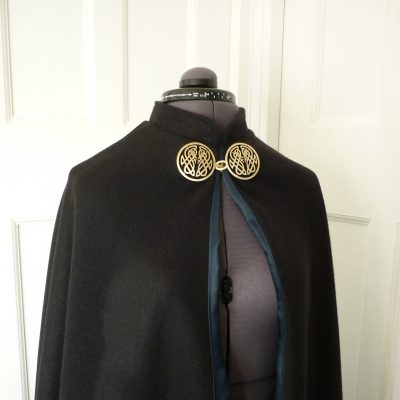 black wool semi-circular cloak with midnight satin lining