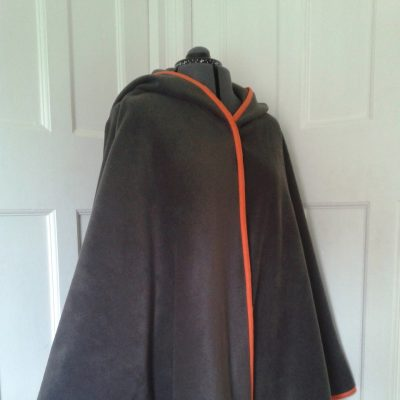 charcoal fleece cape with orange edging