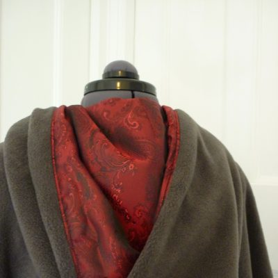 charcoal fleece cape with red jacquard lining