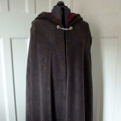 charcoal fleece cloak with a berry lining
