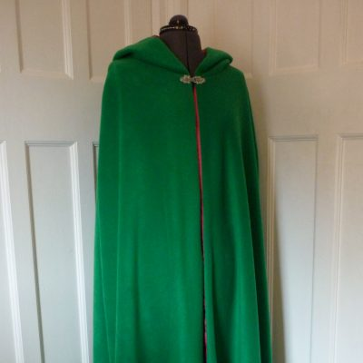 emerald green cloak with pink lining
