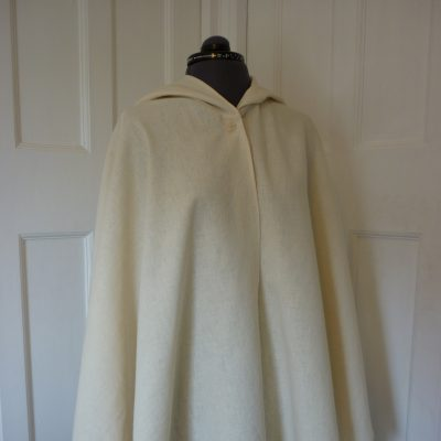 ivory linen cape with button closure