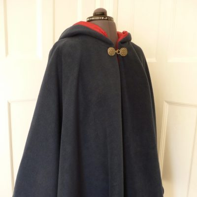 navy fleece cape with red lining