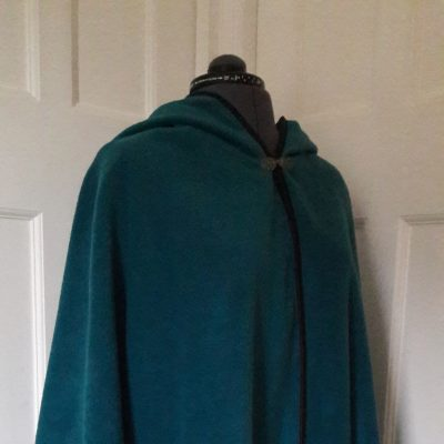 petrol fleece cape with black edging