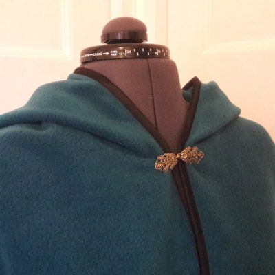petrol fleece cape with black edging