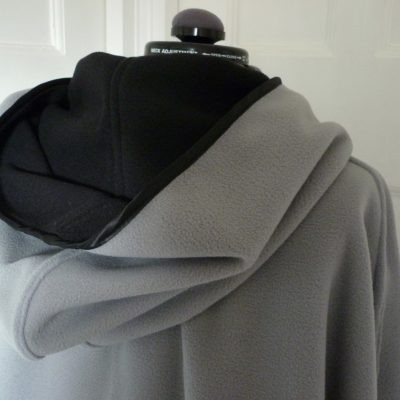 reversible black and grey cape