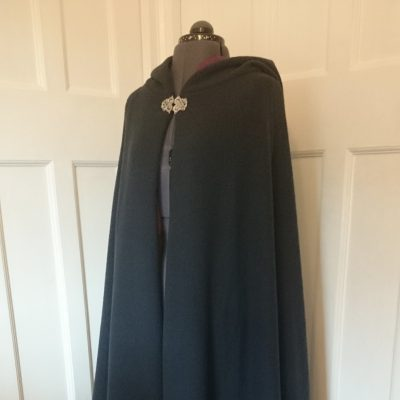 navy semi-circular boiled wool cloak with a burgundy lining